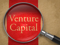 Venture Capital Through Magnifying Glass. Royalty Free Stock Images