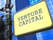 Venture Capital on Yellow Roadsign. On Blue Urban Stock Images