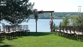 Venue of the wedding ceremony. Wedding arch on a green lawn with stunning river views.