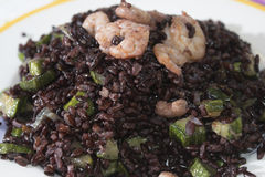 Venus black rice with prawns and courgettes Royalty Free Stock Photo