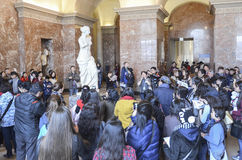 Venus de Milo, Louvre. Famous Venus de Milo at Louvre, Paris, surrounded by the crowd of tourists Royalty Free Stock Photo