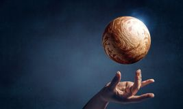 Venus planet in hand. Close of hand taking Venus planet with fingers Stock Photography