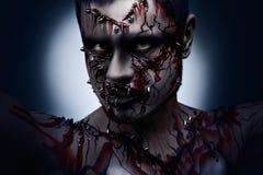Verärgert und blutig. Stockbild