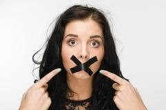 Verärgert weil Band auf Mund Stockfoto