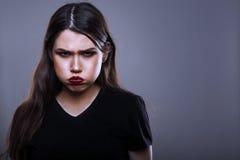 Verärgerte Frau Stockfoto