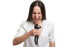 Verärgerte Frau mit kleinem erschrockenem Mann Lizenzfreie Stockfotografie