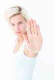 Verärgerte recht blonde Vertretung ihre Hand Stockbild