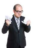 Verärgerter Geschäftsmann reißen Papier auseinander stockbilder