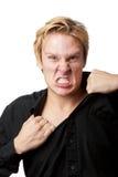 Verärgerter Mann, der sein Hemd zerreißt Stockfotos