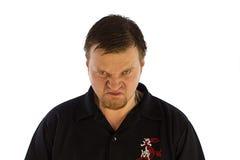 Verärgerter Mann, der vorwärts schaut Lizenzfreies Stockfoto
