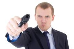 Verärgerter Mann im Anzugschießen mit dem Gewehr lokalisiert auf Weiß Stockbild