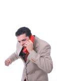 Verärgerter Mann am Telefon Stockbilder