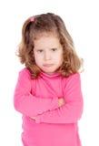 Verärgertes kleines Mädchen im Rosa Stockfotografie