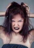 Verärgertes Mädchen mit den schwarzen Lippen Lizenzfreies Stockbild