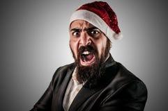 Verärgertes modernes elegantes Weihnachtsmann babbo natale Stockfotos