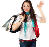 Ver happy woman out shopping. A beautiful happy woman shopping and waving to a friend Stock Photography