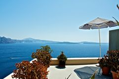 On the veranda. With a small, cozy verandas with spectacular views. Blue Aegean Sea stretching to the horizon. On the horizon are seen the mountains shrouded in Stock Photography