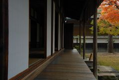 Veranda. Engawa of a traditional Japanese wooden residential house with shoji sliding paper dors and tatami floors Royalty Free Stock Image