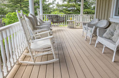Veranda Filled with White Wicker Furniture Stock Photos
