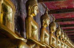 Veranda of Gild Buddha Sculptures at Wat Suthat, Bangkok of Thailand. Veranda of hundreds gild Buddha sculptures is a landmark of Wat Suthat is a great temple Royalty Free Stock Image