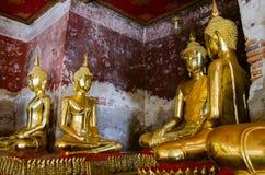 Veranda of Gild Buddha Sculptures at Wat Suthat, Bangkok of Thailand. Veranda of hundreds gild Buddha sculptures is a landmark of Wat Suthat is a great temple Royalty Free Stock Photo