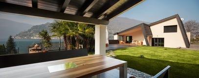 Veranda of modern villa overlooking the garden Royalty Free Stock Image