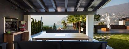 Veranda of modern villa overlooking the garden Royalty Free Stock Photo