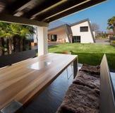 Veranda of modern villa overlooking the garden Stock Photography