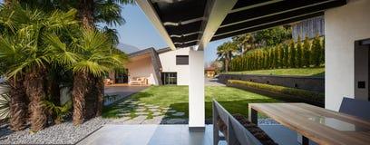 Veranda of modern villa overlooking the garden Stock Photos