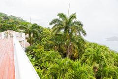 Veranda Overlooking Lush Greenery and St Thomas Bay Royalty Free Stock Photos