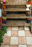 Veranda of a private house. Flowers on the veranda of a private house royalty free stock photo