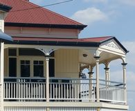 Verandah on Queenslander. Tin roof, gabled, heritage coloured Queenslander style home, with wrap around verandah Stock Photos