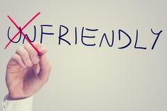 Veranderend het woord Vijandig in Vriendschappelijk stock foto's