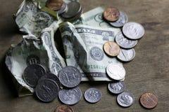 Verandering en verfrommeld bankbiljet Stock Afbeelding