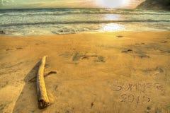 Verano 2015 que escribe en la puesta del sol Foto de archivo