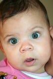 Verbaasd babygezicht Stock Foto