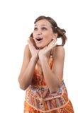 Verbaasd meisje in oranje kleding Royalty-vrije Stock Afbeeldingen