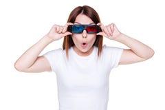 Verbaasd meisje in stereoglazen Stock Foto's