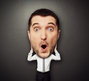 Verbaasde mens met groot hoofd Stock Fotografie