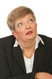Verbaasde rijpe uitvoerende vrouw Royalty-vrije Stock Foto