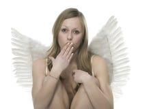 Verbaasde vrouw met verbaasde engelenvleugels Royalty-vrije Stock Afbeeldingen