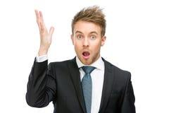 Verbaasde zakenman met open omhoog mond en hand Royalty-vrije Stock Afbeeldingen