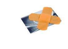 Verband auf Kreditkarte Stockbild