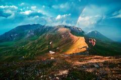 Verbazende regenboog op de bovenkant van Grossglockner-pas royalty-vrije stock foto's