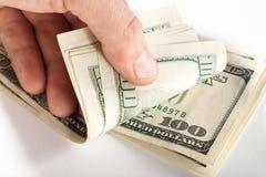 Verbiegendes Geld Stockfotos