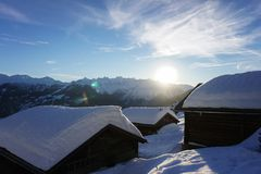 Verbier sunset over mountain huts stock photography