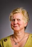 Verbijsterde vrouw op middelbare leeftijd Stock Foto's