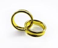 Verbonden gouden geïsoleerdev ringen Stock Afbeelding