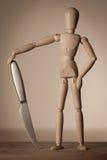 Verbonden pop met een mes Royalty-vrije Stock Afbeeldingen