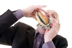 Verbrauchende Dollar des Habsuchtgeizes Lizenzfreie Stockbilder